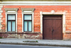 Facade of an old building with two windows and  door Stock Photos