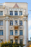 Facade of an old building with white columns and balconies Stock Photography
