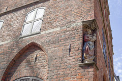Facade of an old bulding with a statue of the Virgin Mary with J Royalty Free Stock Photos