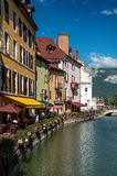 Facade of old and colorful buildings facing the canal in Annecy. Annecy, France - June 30, 2016. Facade of old and colorful buildings facing the canal, in the Stock Photo