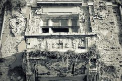 Facade of old destroyed house with broken windows Stock Photos