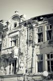Facade of old destroyed house with broken windows Royalty Free Stock Image