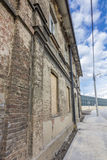 Facade of an old devastated brick building. With blue sky in background royalty free stock images