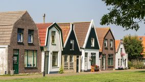Facade of an old Dutch street. Facade of the historical Dutch village Cocksdorp at Texel one of the wadden islands in the Netherlands Royalty Free Stock Photo