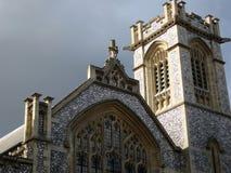 Facade of old English church stock photos