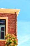 Facade of Old European style Brick Building in Summer Stock Photos