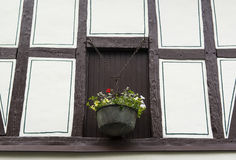 Facade of an old half-timbered house with a vase with flowers, Germany Royalty Free Stock Image