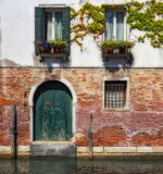 Facade of an old house on a canal in Venice Royalty Free Stock Photography