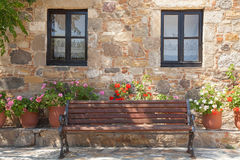 Facade of an old house on Kos island. Facade of an old stone house and a bench in the village Antimachia on the island of Kos, Greece Royalty Free Stock Images