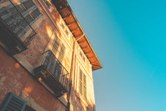 Facade of an old house at sunset Stock Photography