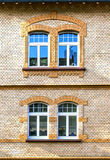 Facade of an old house with two window Royalty Free Stock Photography