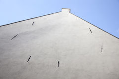 Facade of old house with white stucco without windows Royalty Free Stock Photo