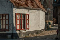 Facade of old house and window on an empty street, in the late afternoon light at Damme. A quiet and charming countryside old village near Bruges. Northwestern Royalty Free Stock Photos