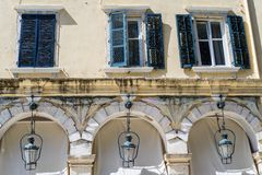 Facade of the old house with windows and arches Royalty Free Stock Image