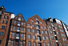 Facade of old houses against blue sky Royalty Free Stock Photography