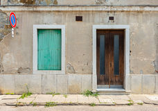 Facade of the old Italian house with green shutters on the window, Italy Royalty Free Stock Photos