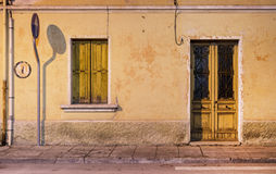 Facade of old italian house with yellow window and doors, Palmanova Stock Images
