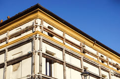 Facade of an old italian masonry building with metal tie-rod, containment straps and anchor plate. royalty free stock image
