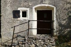 Facade of old mountain house Stock Image