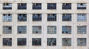 Facade of an old neglected factory building Royalty Free Stock Image
