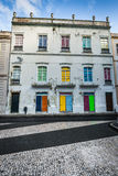 Facade of the old Portuguese houses with colorful doors and wind Royalty Free Stock Photos