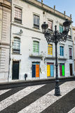 Facade of the old Portuguese houses with colorful doors and wind Royalty Free Stock Image
