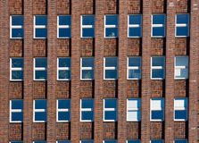 Facade of an old red brick building Royalty Free Stock Image