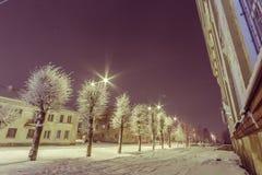 Facade of old school building. Winter landscape. Night. Royalty Free Stock Photos
