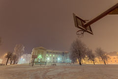 Facade of old school building. Winter landscape. Night. Royalty Free Stock Images