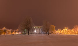 Facade of old school building. Winter landscape. Night. Stock Photography