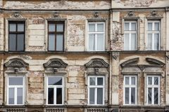 The facade of the old shabby brick house with Windows.  royalty free stock images
