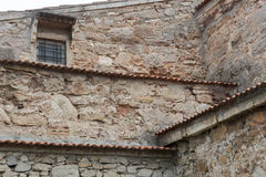 The facade of the old stone building. Royalty Free Stock Image