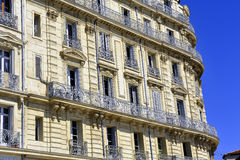 Facade of an old stone building on the old port of Marseill Stock Images