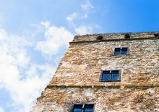 Stone wall with windows on the blue sky background, Nidzica royalty free stock photo