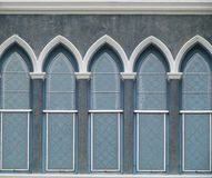 Facade of Old Stucco Glass Window Stock Image
