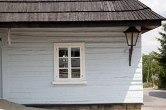 The facade of the old wooden house with a lantern.  royalty free stock image