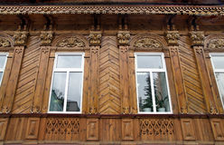 The facade of an old wooden house after restoration. Detail of the facade of old wooden houses of the 19th century, after the restoration, Penza Stock Images