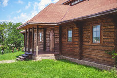 Facade of old wooden house summer day Stock Photography