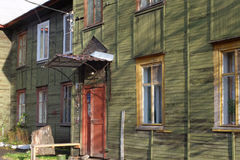 Facade of old wooden house at sunset autumn day Stock Photo