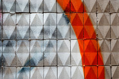 Facade with painted  ceramic triangular tiles Stock Image