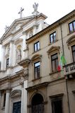 Facade of a palace and a church in Corso Palladio in Vicenza in Veneto (Italy) Stock Image
