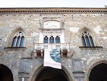 Facade of Palazzo della Ragione in Bergamo town. BERGAMO, ITALY - FEBRUARY 19, 2019: facade of Palazzo della Ragione on Piazza Vecchia square in Citta Alta Upper stock photography