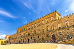 Facade of Palazzo Pitti palace with Gallery of Modern Art large building on Piazza dei Pitti square in historical centre of Floren. Ce city, blue sky white stock photo