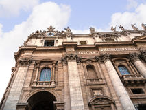 Facade of the Papal Basilica of St. Peter in Vatican City. Designed principally by Donato Bramante, Michelangelo, Carlo Maderno and Gian Lorenzo Bernini, St stock images