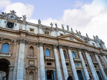 Facade of the Papal Basilica of St. Peter in Vatican City. Designed principally by Donato Bramante, Michelangelo, Carlo Maderno and Gian Lorenzo Bernini, St Royalty Free Stock Photos