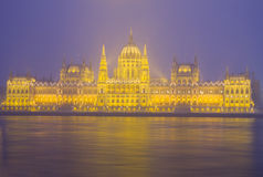 Facade of parliament at night, Budapest Stock Photo