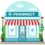 Facade pharmacy store with a signboard, awning and symbol in shopwindow. Royalty Free Stock Photography