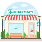 Facade pharmacy store with a signboard, awning and symbol in shopwindow. Royalty Free Stock Photos