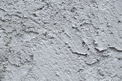 Facade plaster background. Single-ply monolithic plaster decorative background. Single layer scraped cement plaster wallpaper. Exterior building structure royalty free stock image
