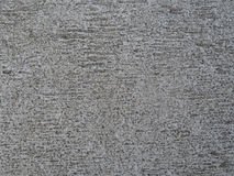 Facade plaster grit texture - beige small stones and sand - wall. Background Stock Images